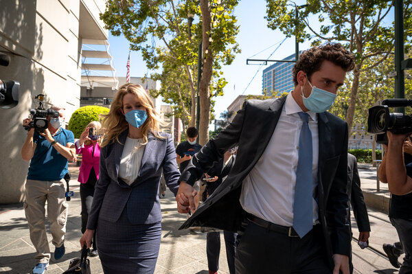 Elizabeth Holmes, the Theranos founder, with her husband, Billy Evans, outside the federal courthouse in San Jose, Calif., last week.