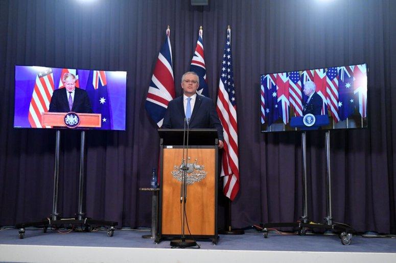 澳大利亚总理斯科特·莫里森与英国首相鲍里斯·约翰逊、美国总统拜登一起举行新闻发布会。