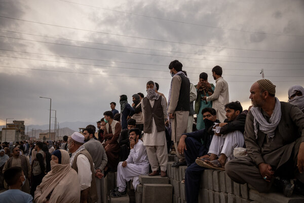 Thousands of Afghans waiting outside Kabul's airport on Friday as they attempted to flee the country.