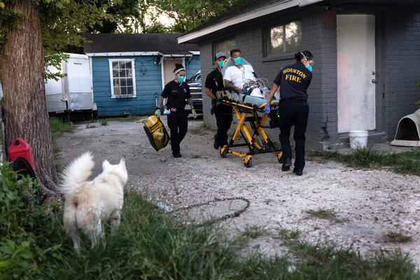 Paramedics transported a man with Covid symptoms to a hospital in Houston, Texas, earlier this week.
