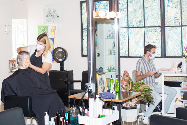 A salon in the Elysian Valley neighborhood of Los Angeles in July.Almost 70 percent of Californians age 12 and older have been fully immunized against the coronavirus.