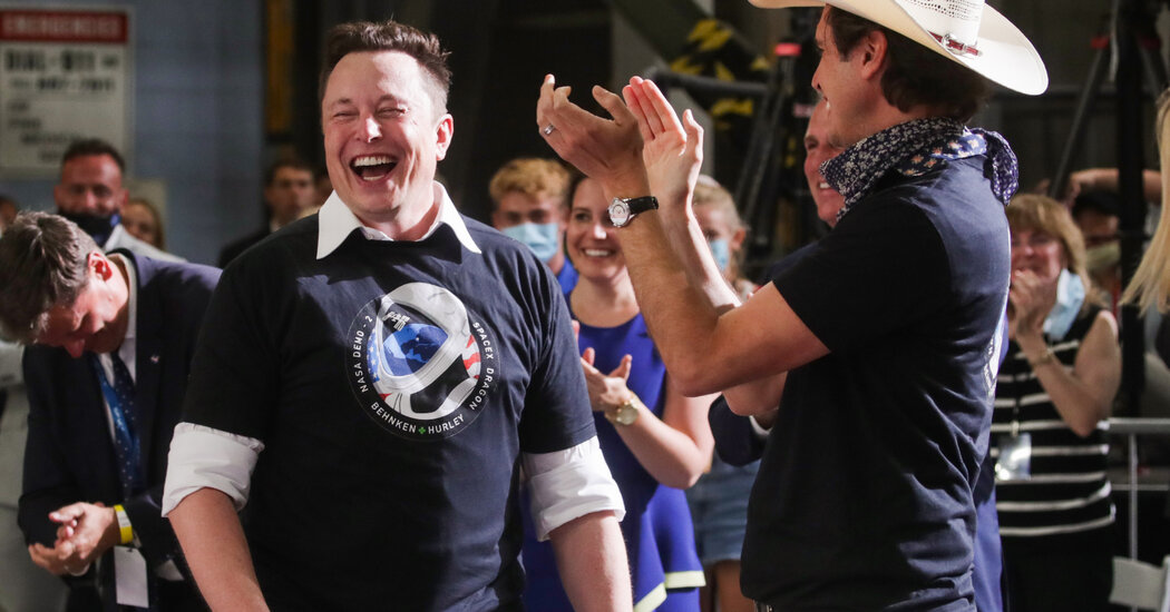 Live Business and Economy News: Tesla, NBC Universal and Holmes Trial