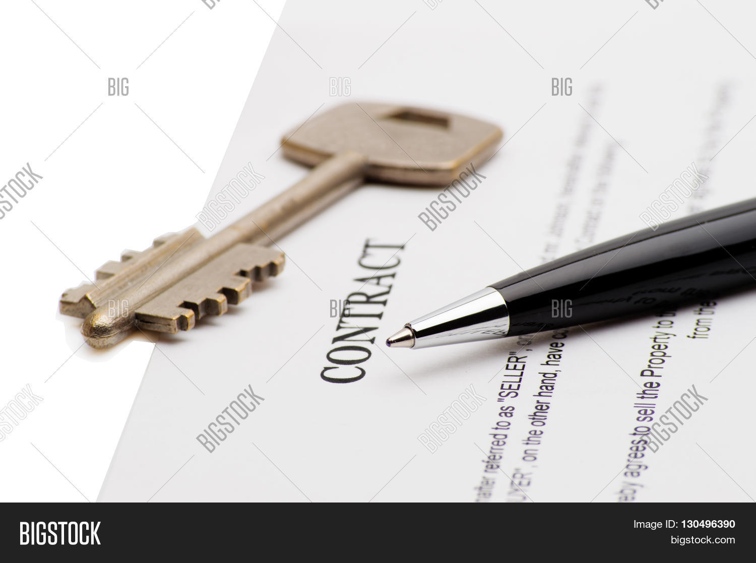 Keys Of A New House On A Signed Contract Of House Sale With Money In  Background