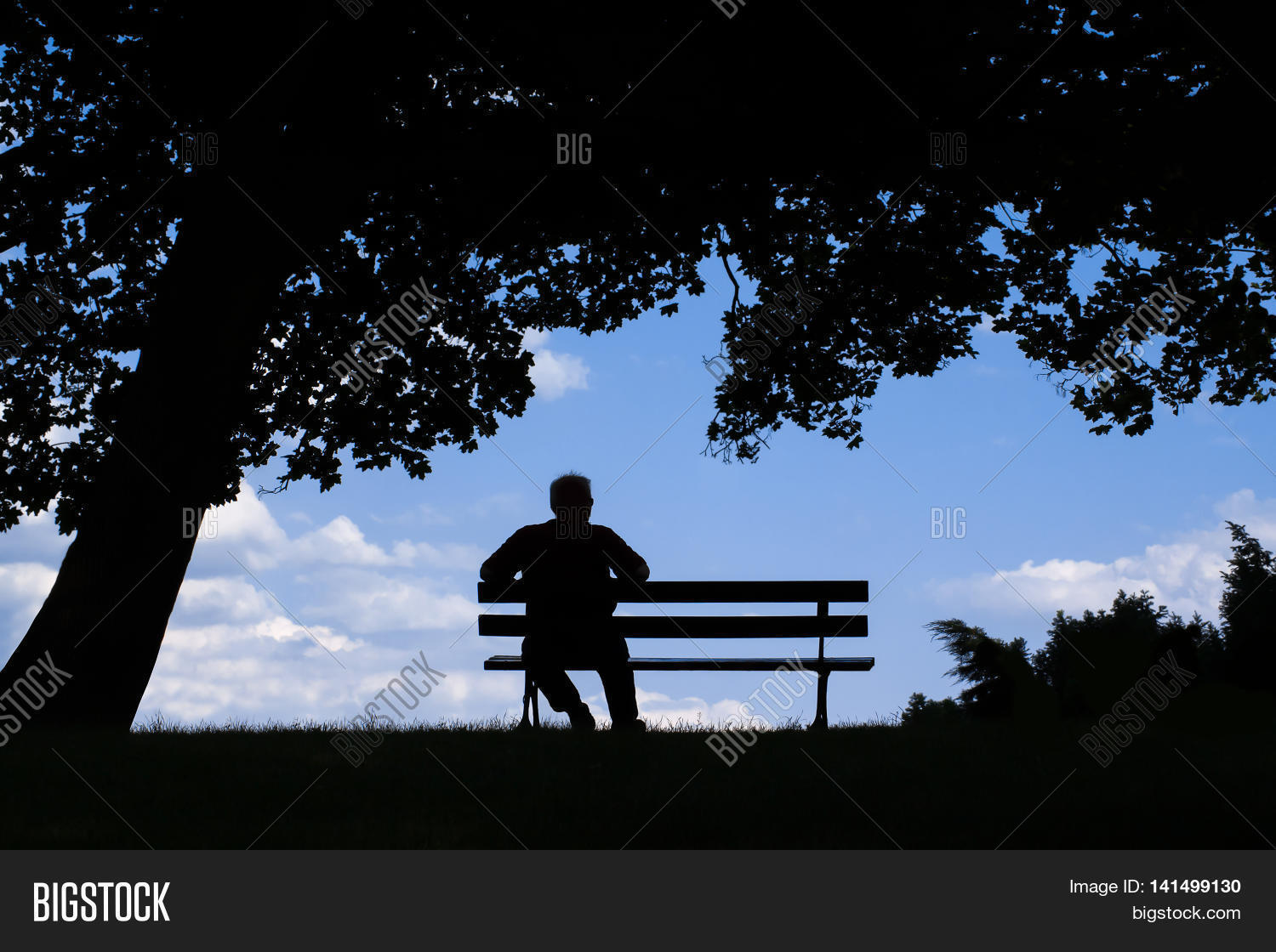 old man sitting alone