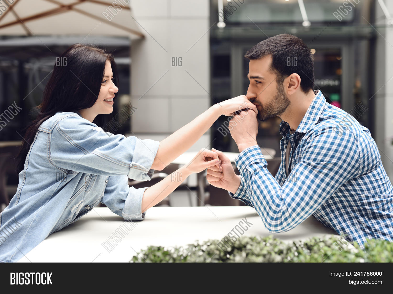 guy kisses hand girl