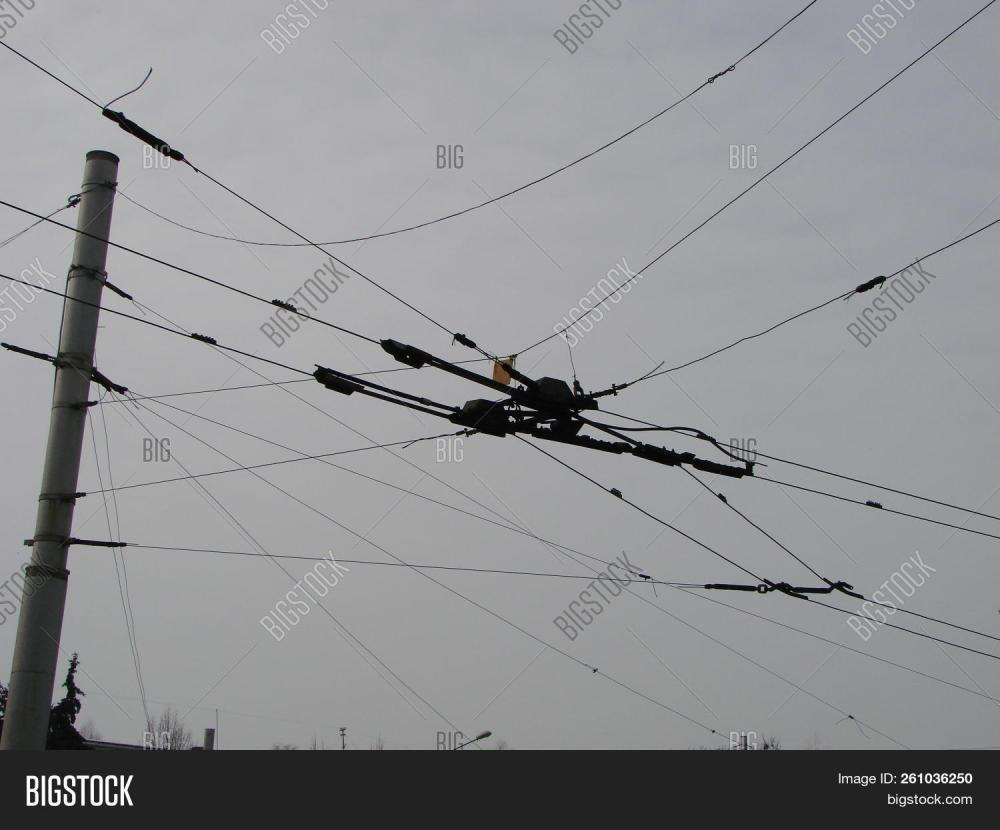 medium resolution of wires pole with blue sky electrical wires on a background electric cables power