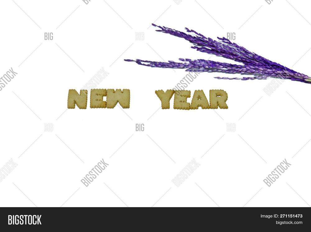 medium resolution of biscuit alphabets of the word new year with blur purple ears of rice on white isolated