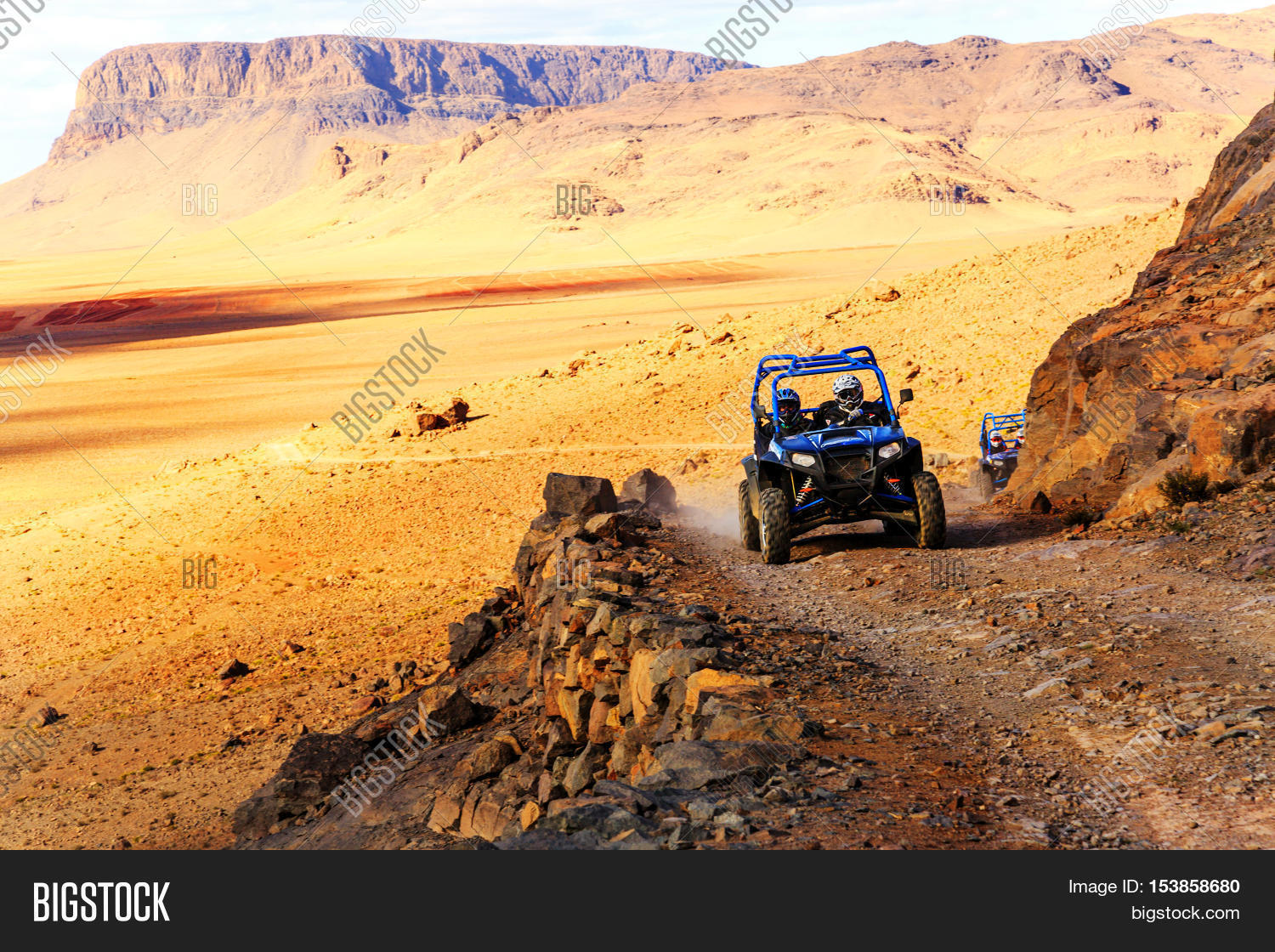 hight resolution of merzouga morocco feb 21 2016 blue polaris rzr 800 crossing a mountain road in