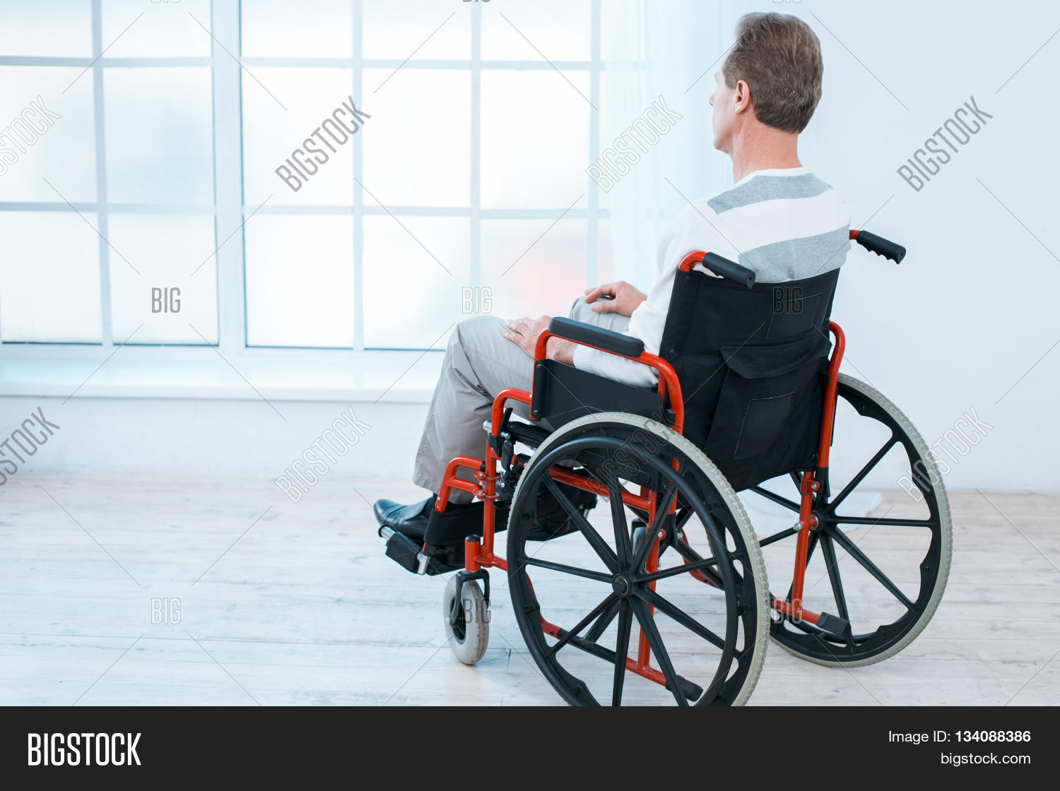 wheelchair man stokke tripp trapp high chair adult image photo free trial bigstock in white interior with big window sad looking at