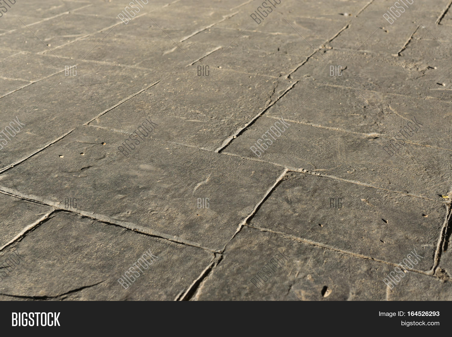 gray stamped concrete image photo