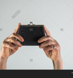 senior woman an elderly pensioner holding leather wallet old woman hands with a wallet [ 1500 x 1120 Pixel ]