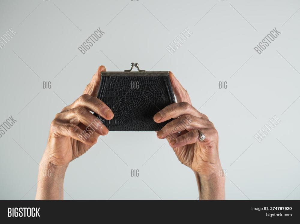 medium resolution of senior woman an elderly pensioner holding leather wallet old woman hands with a wallet
