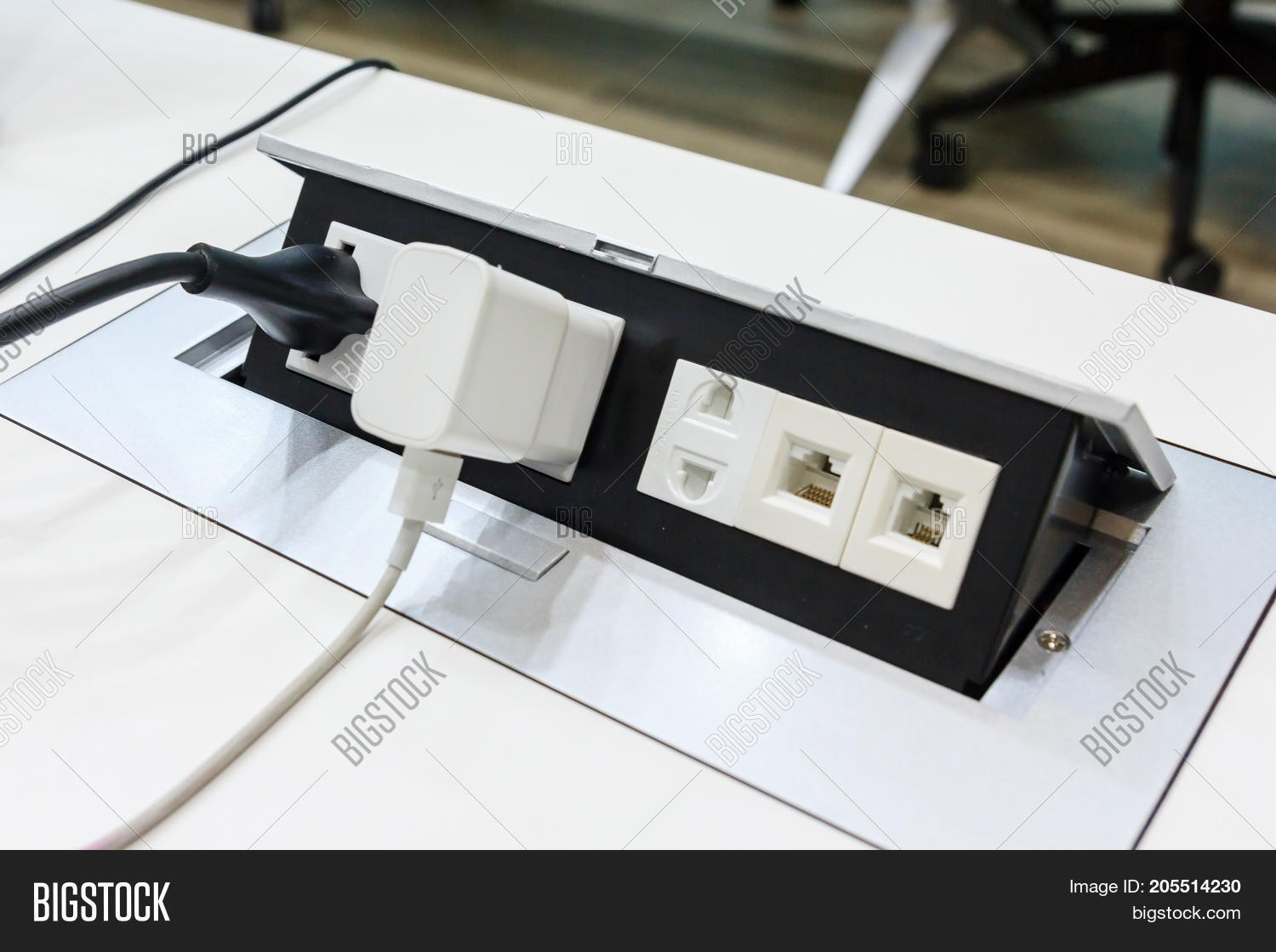 hight resolution of electrical outlet with dual 3 pin phone jack plugs and network plugs on a white table