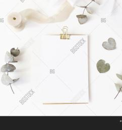 feminine wedding desktop stationery mockup with blank greeting card dry eucalyptus leaves silk rib [ 1500 x 1120 Pixel ]