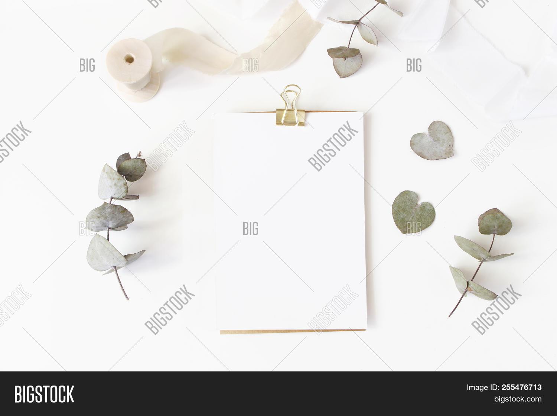 hight resolution of feminine wedding desktop stationery mockup with blank greeting card dry eucalyptus leaves silk rib
