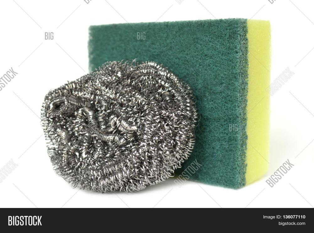 medium resolution of scrub sponge and steel wool on white background