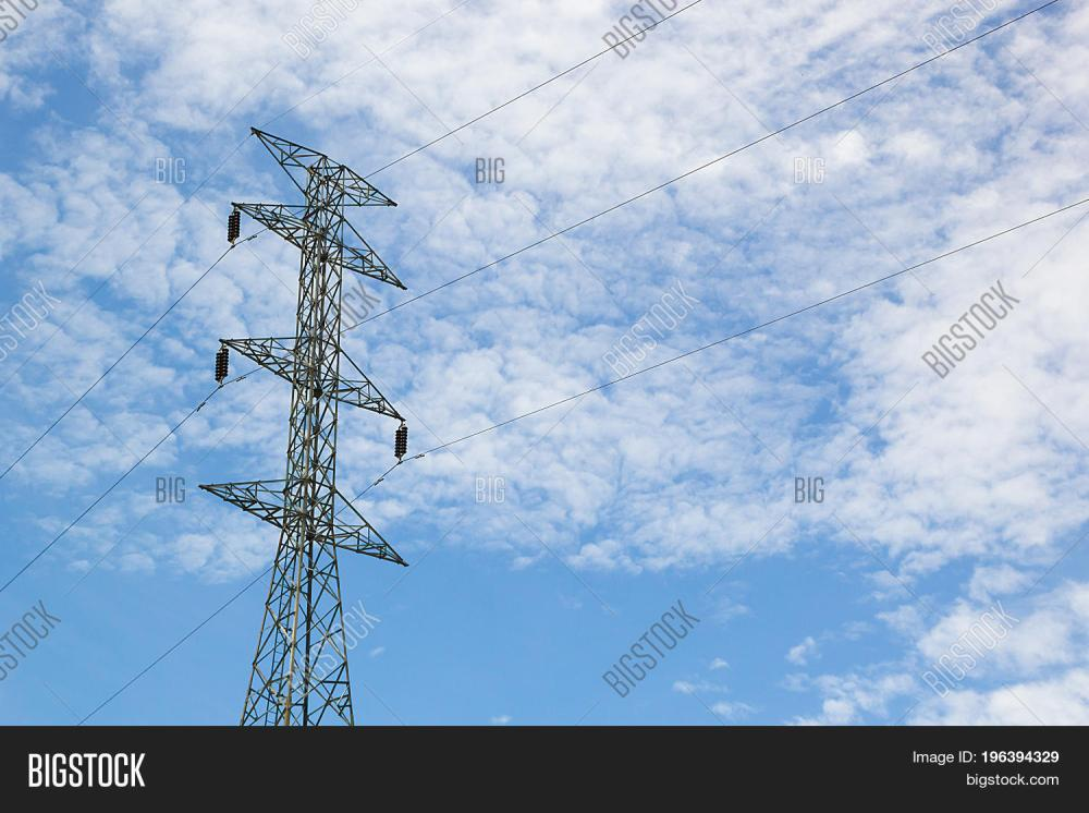 medium resolution of high voltage post high voltage tower at blue sky and cloud background power poles and