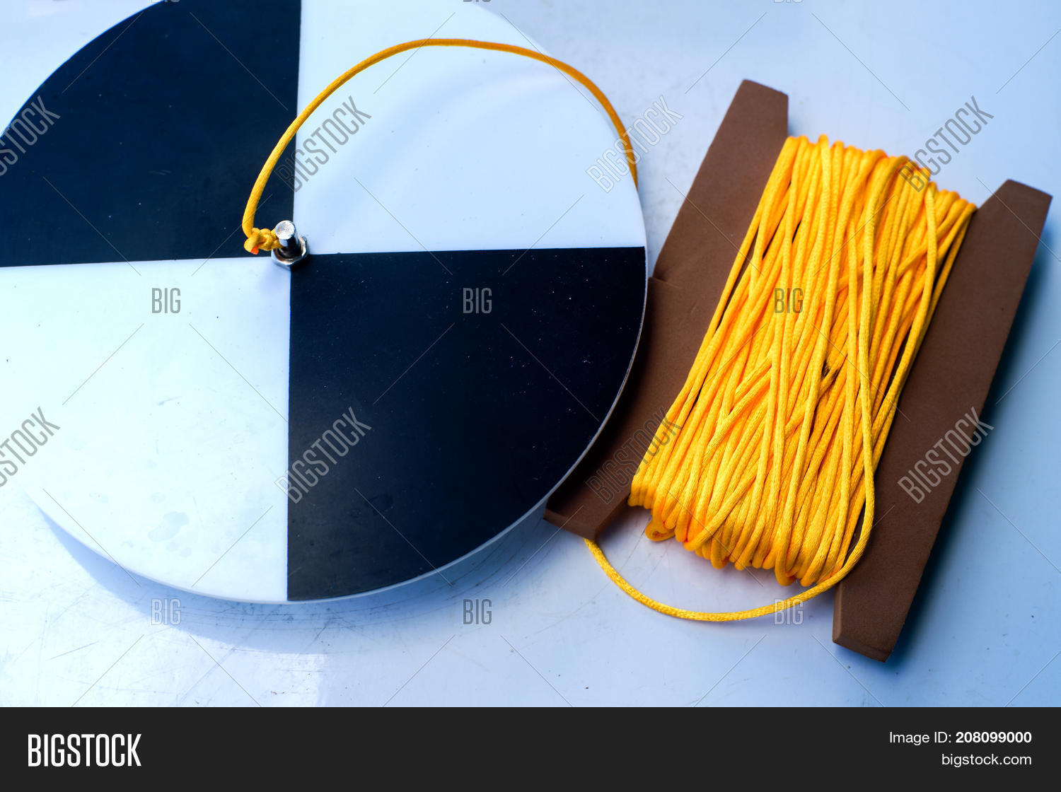 hight resolution of secchi disk with rope on a white table prepared for water transparency measurement