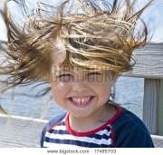 windy hair girl beach