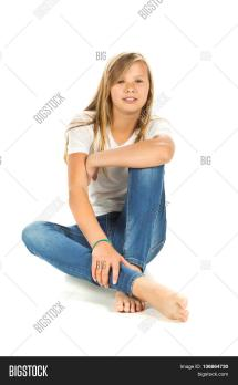 Young Girl Sitting Barefoot White T & Bigstock