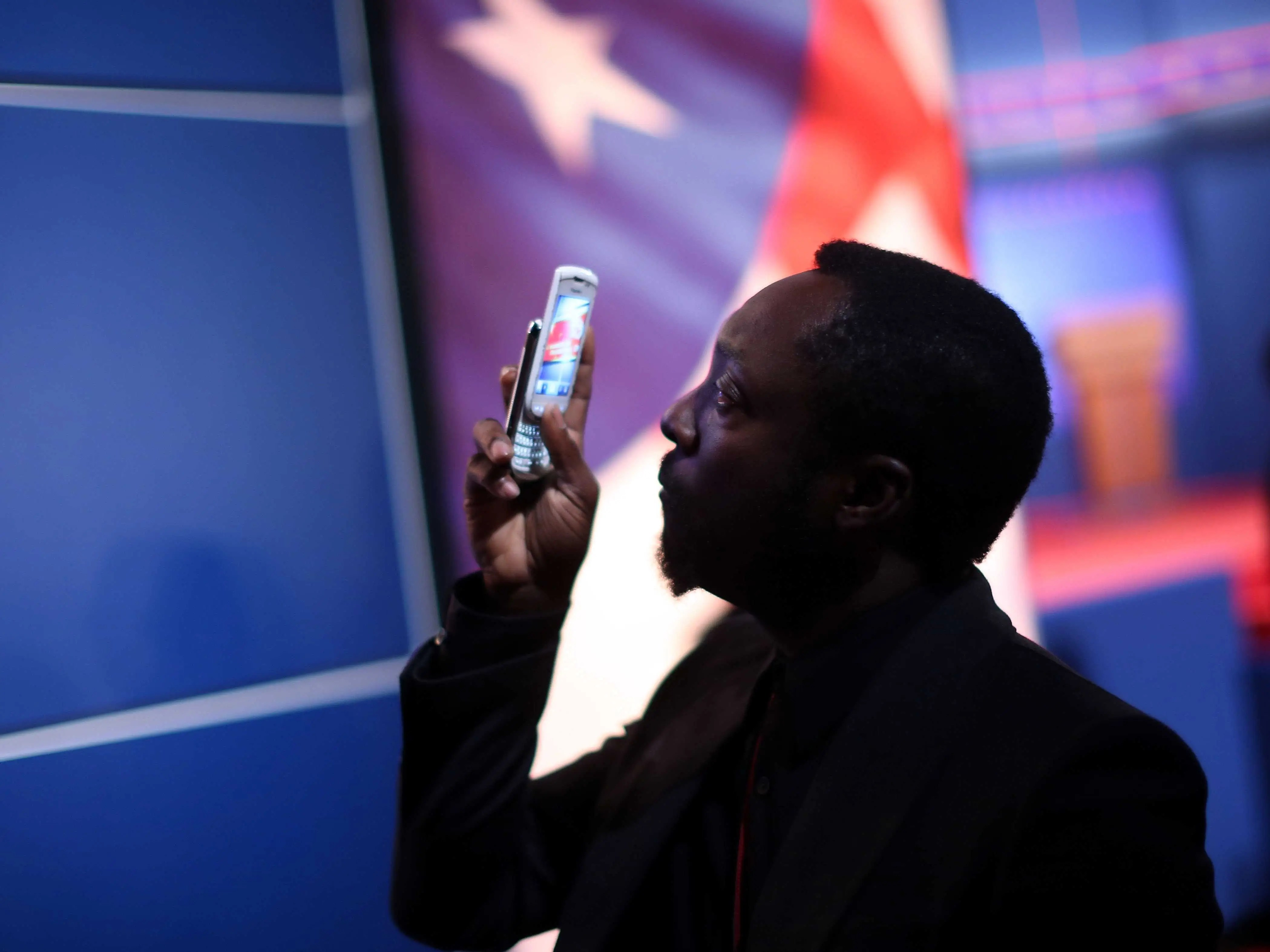 Oct. 3, 2012: Will.i.am takes a picture on his BlackBerry Torch prior to the Presidential Debate at the University of Denver.