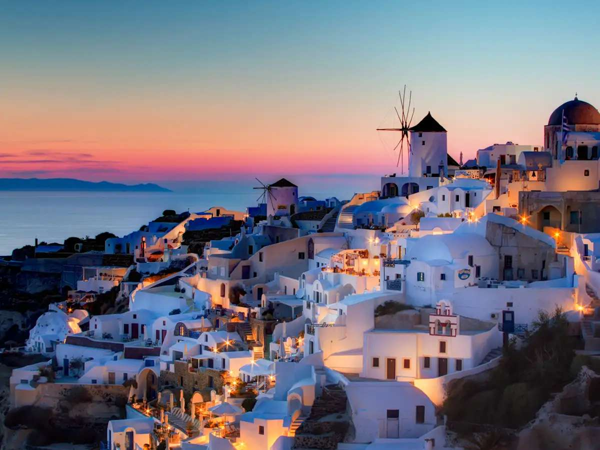 Watch the sun set over the Mediterranean Sea from Santorini, one of the most beautiful Greek islands.