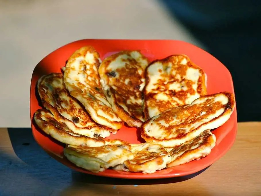 RUSSIA: Traditional breakfast is sirniki, or baked farmers cheese pancakes, and hot oatmeal. Rye bread is another staple.