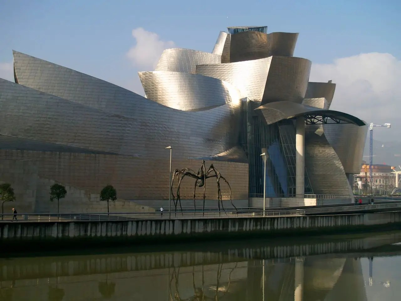 65. Made out of glass, limestone, and titanium, Frank Gehry's Guggenheim Bilbao in Spain shimmers in the sunlight.