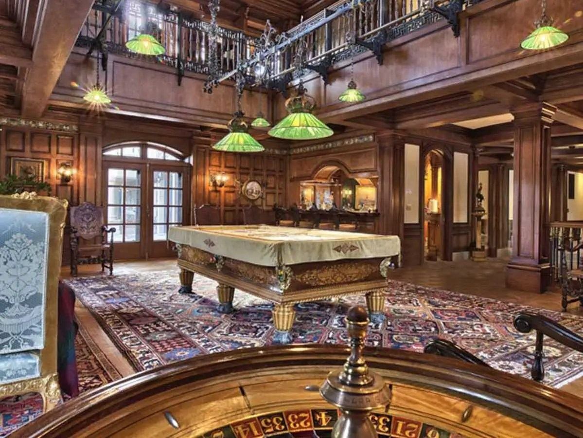 It would be fun to throw a party in the expansive billiards room.