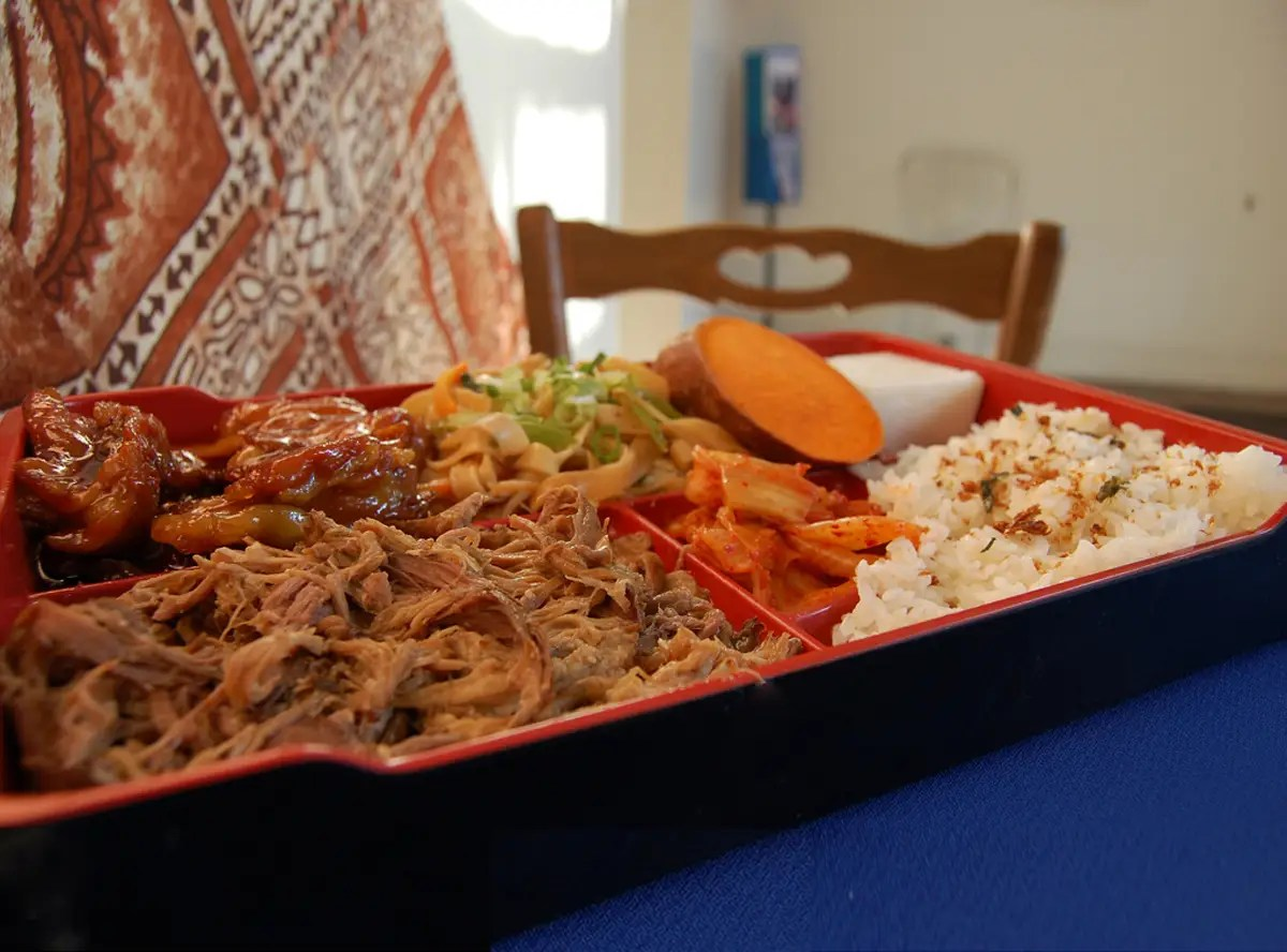 HAWAII: Savor a mouthful of traditional, slow-roasted Kalua pork with a side of fried rice.