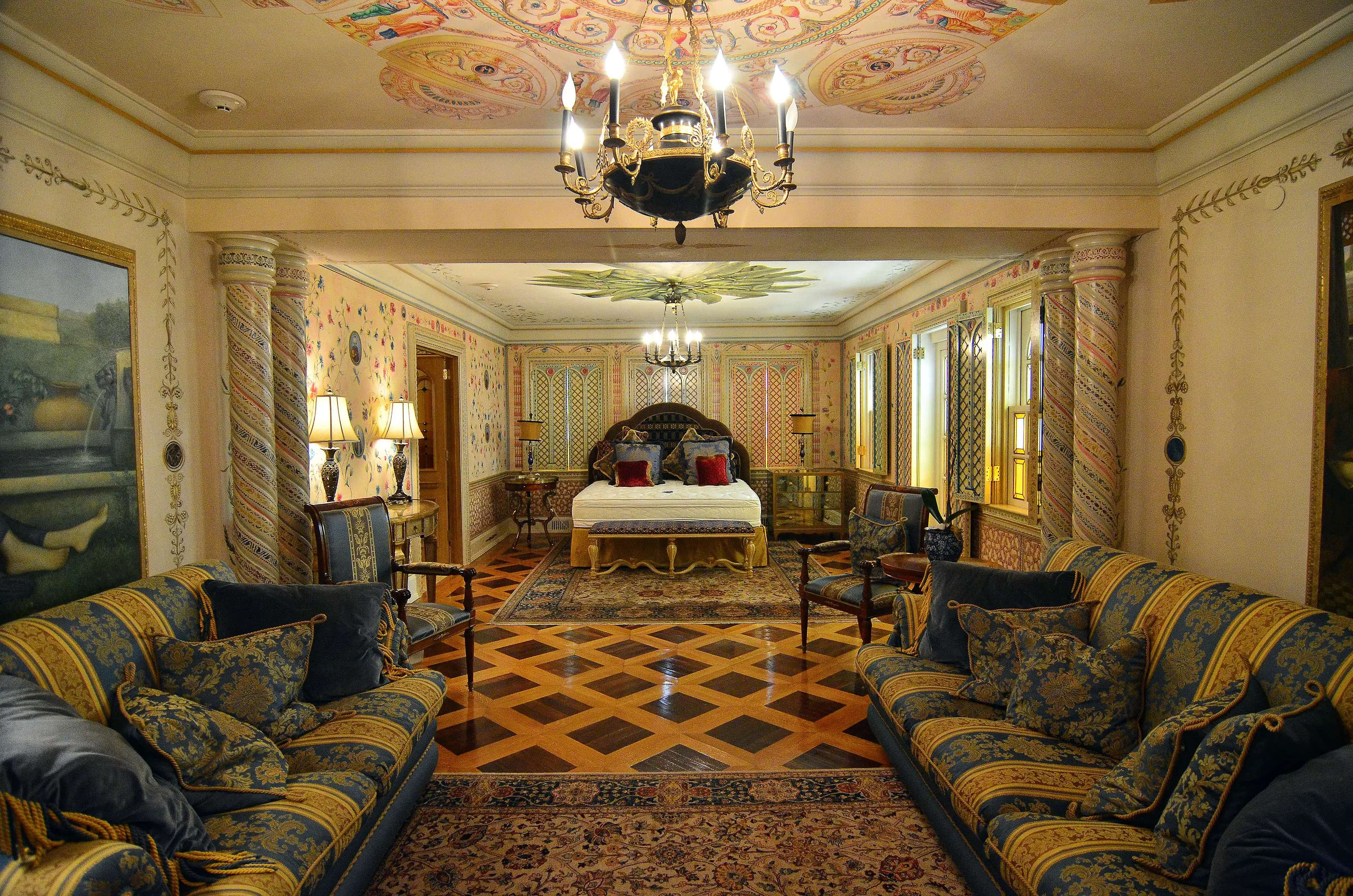 With columns, Moroccan couches, and a chandelier, this humongous suite has just about everything.