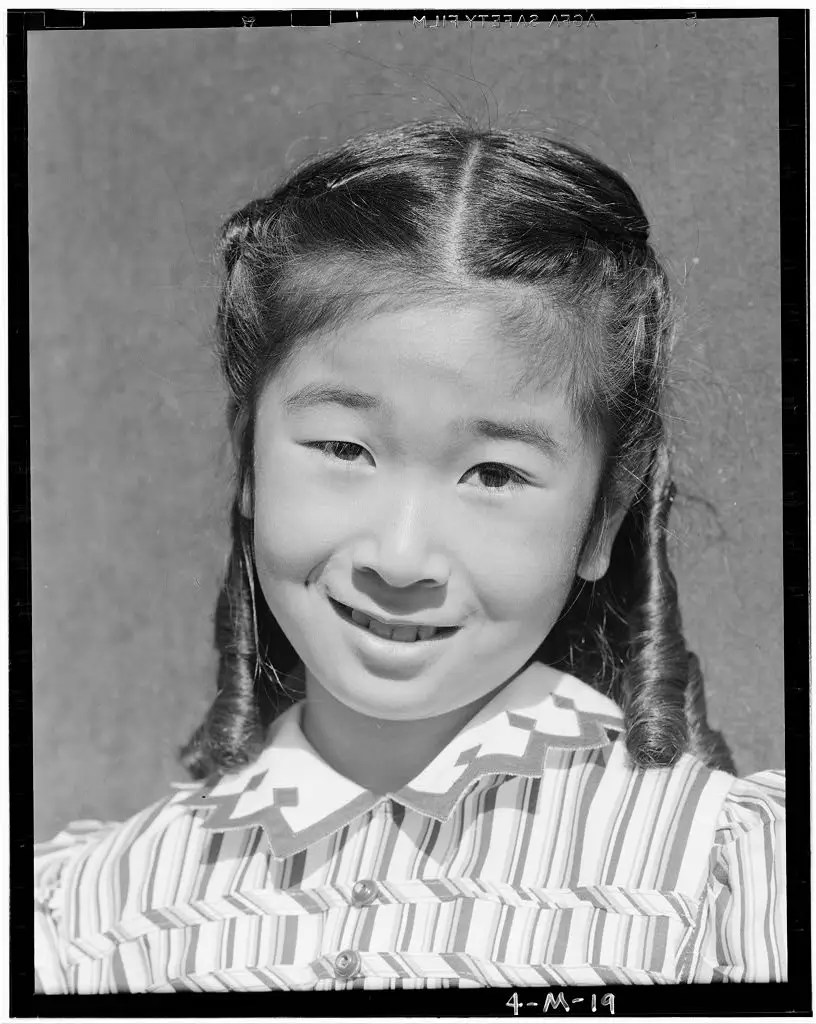 In many instances, Adams took portraits of the people whose daily lives he photographed, like this one of the same little girl, Joyce Yuki Nakamura.
