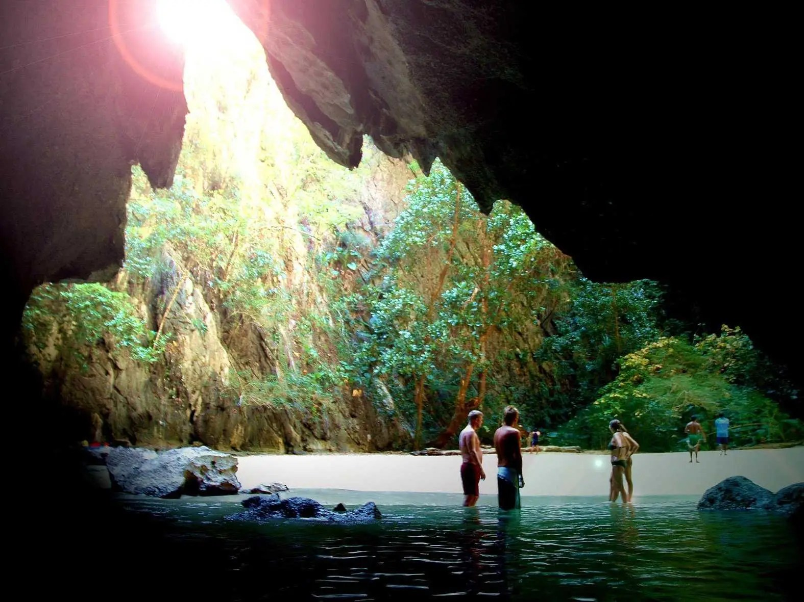 Swim to the private beach of Morakot Cave in Koh Mook, Thailand.