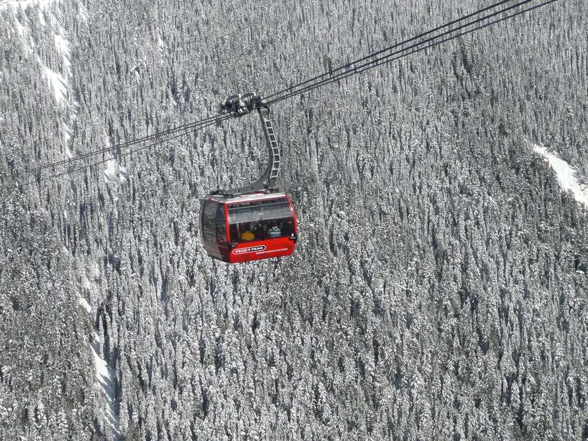 Ride a gondola between Canada's breathtaking Whistler and Blackcomb Mountains.