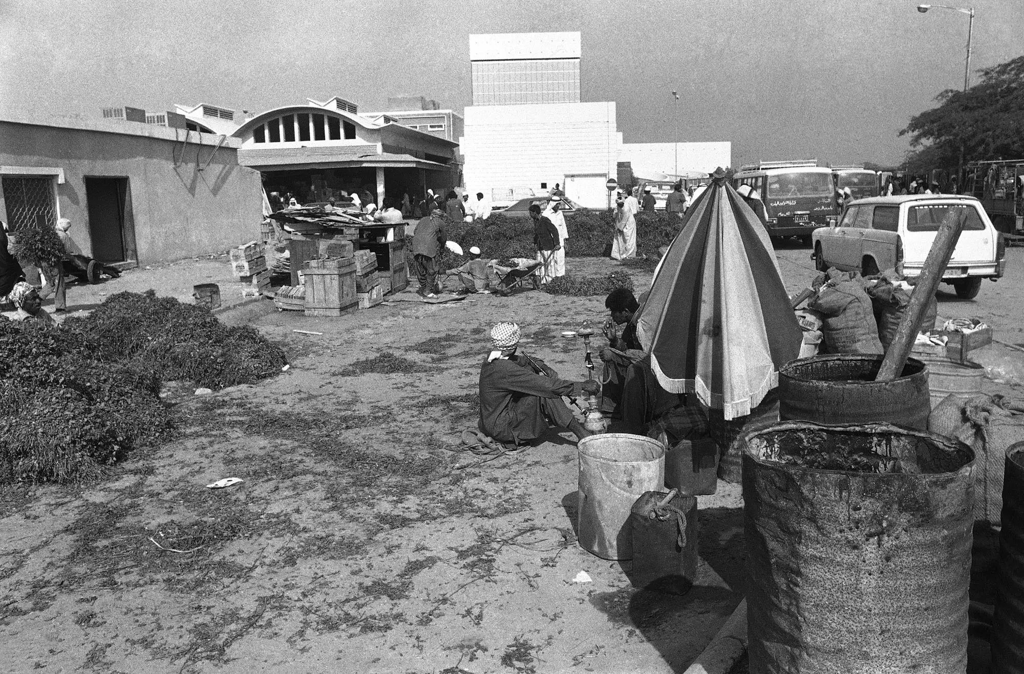 This was part of Doha's open-air market in 1977. Piles of garbage and loiterers smoking hookah were not an uncommon site.