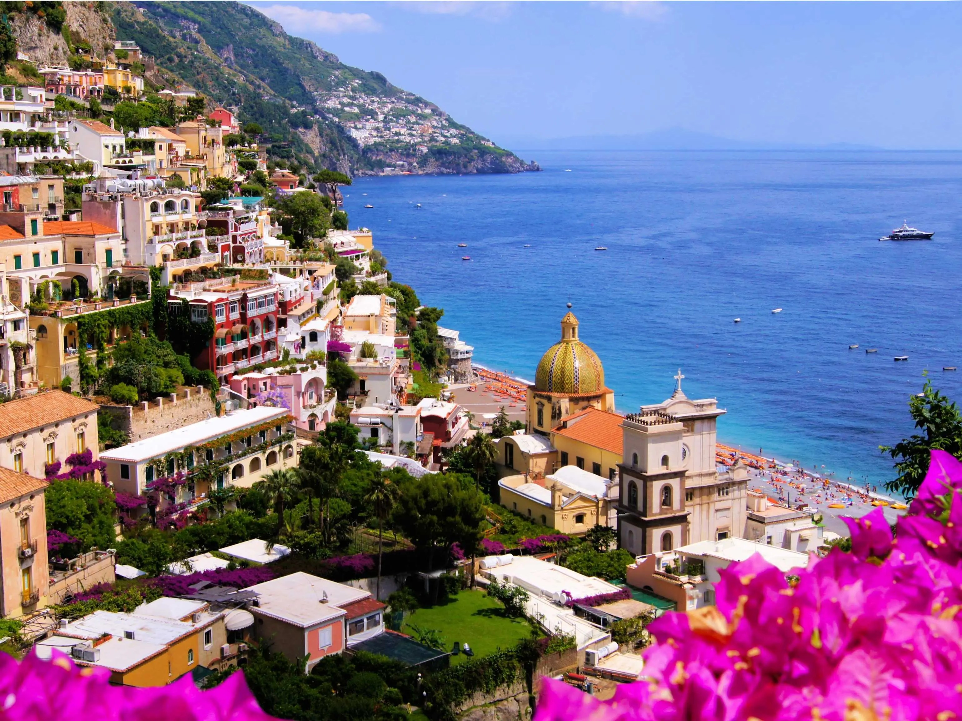 Hug the cliffs while driving along the Amalfi Coast in Italy, and visit the charming towns of Positano, Ravello, and Salerno.