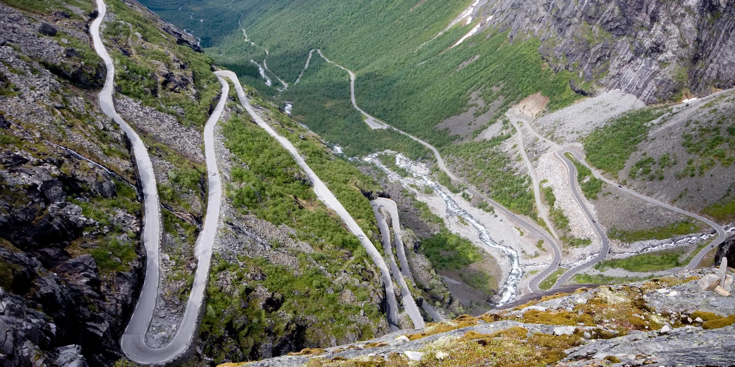 "The Trollstigen road in Norway means ""troll ladder,"" and that name is very fitting for this extremely narrow and steep winding road. If you make it to the top, you'll be rewarded with views of the Stigfossen waterfall, a 1,050-foot waterfall that tumbles over the mountains."
