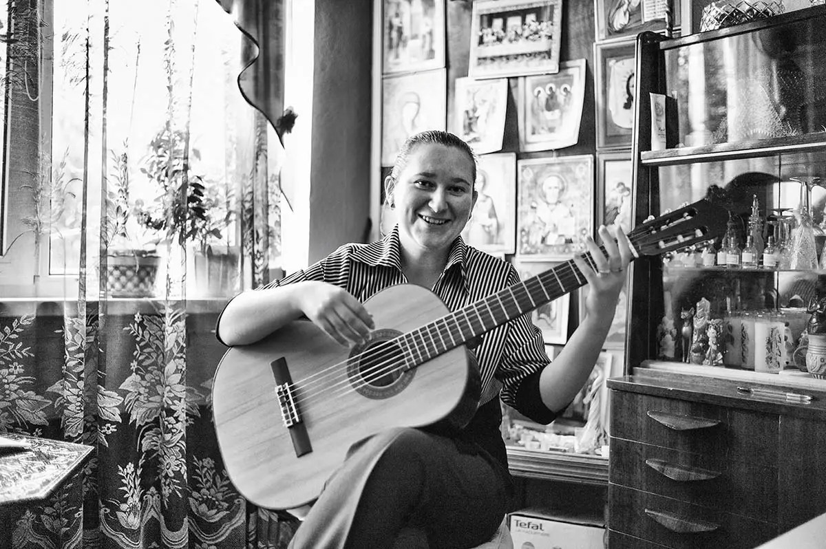 "Anna, age 29. Profession: Musician. Passion or Dream: ""I love singing and performing — my solo concerts, playing the guitar, psychology, philosophy, traveling and studying other cultures and religions."""