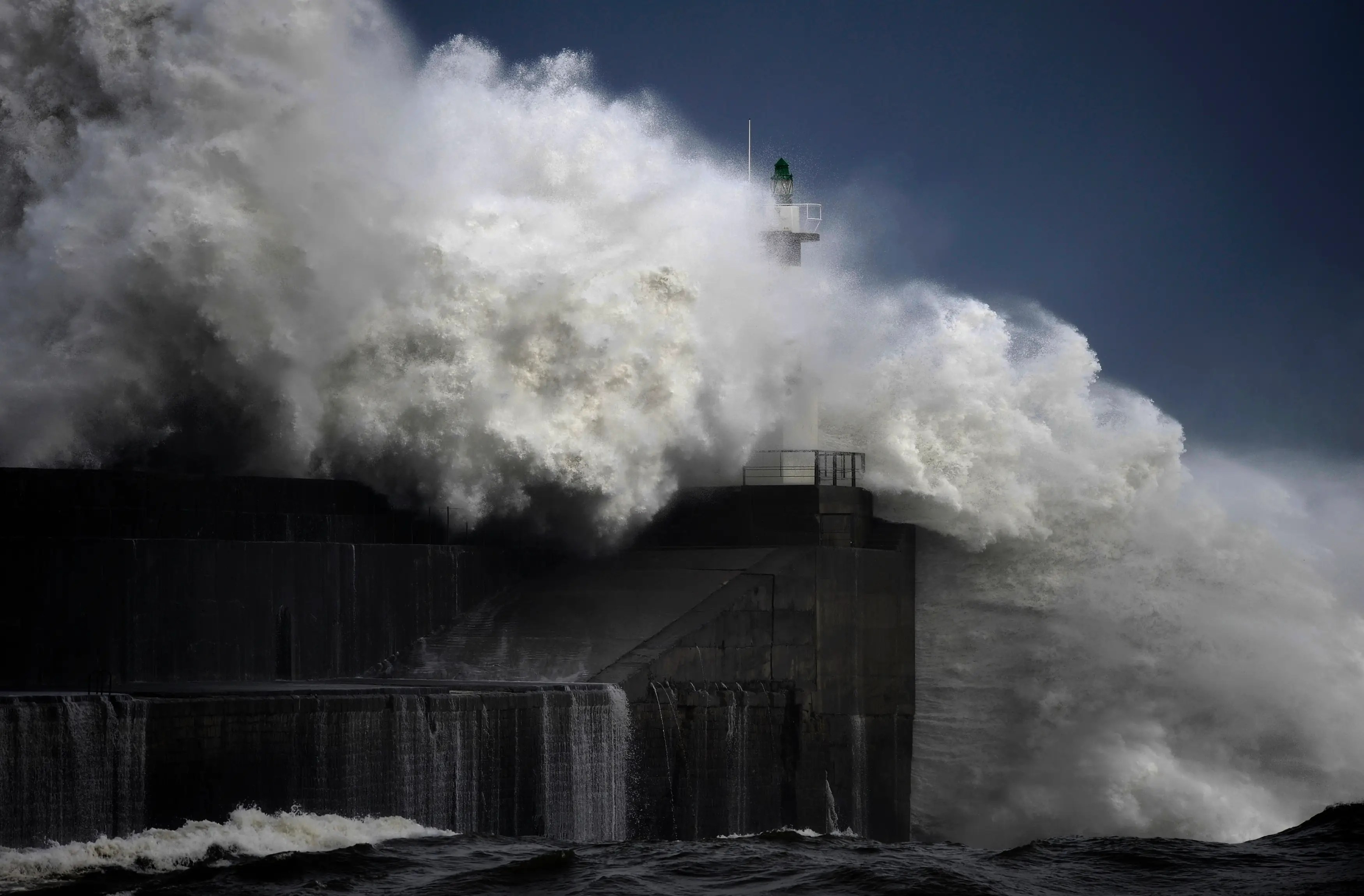 Huge waves crash on the seafront in northern Spain.