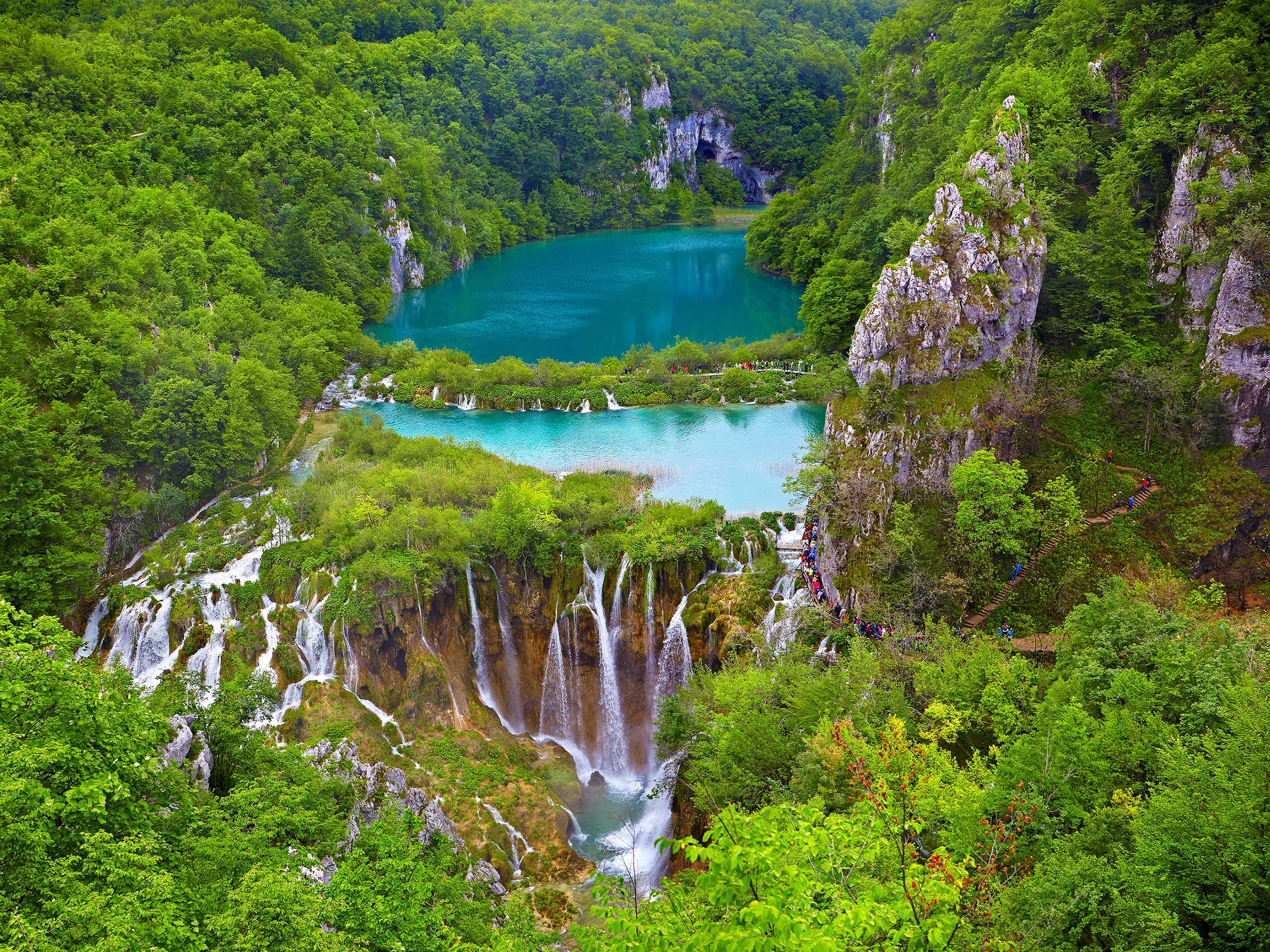 Walk through Croatia's Plitvice Lakes, a UNESCO World Heritage Site with stunning lakes, caves, waterfalls, and an array of wildlife.