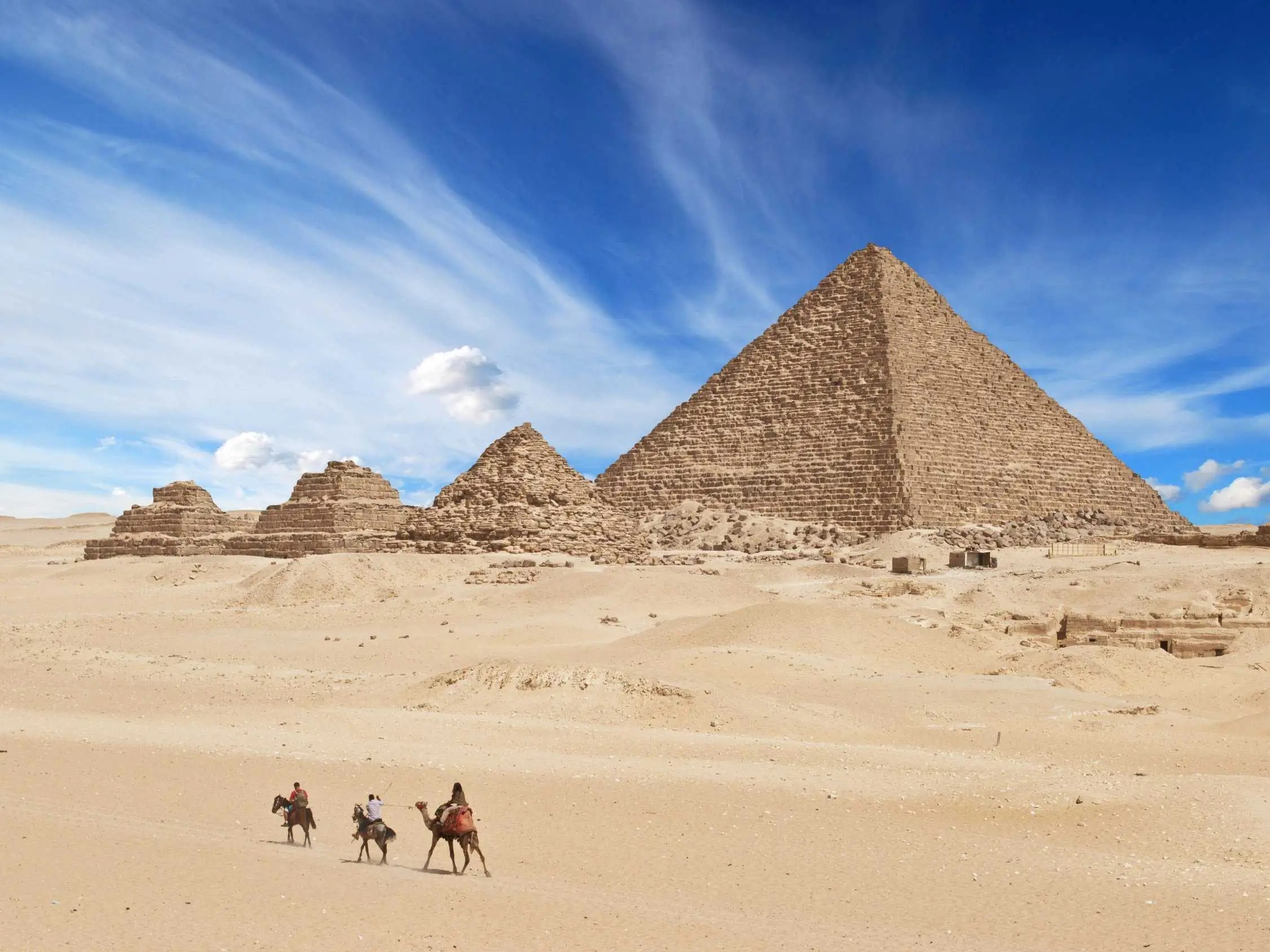 Visit the Great Pyramids of Giza in Egypt, the only one of the seven ancient world wonders still in existence.