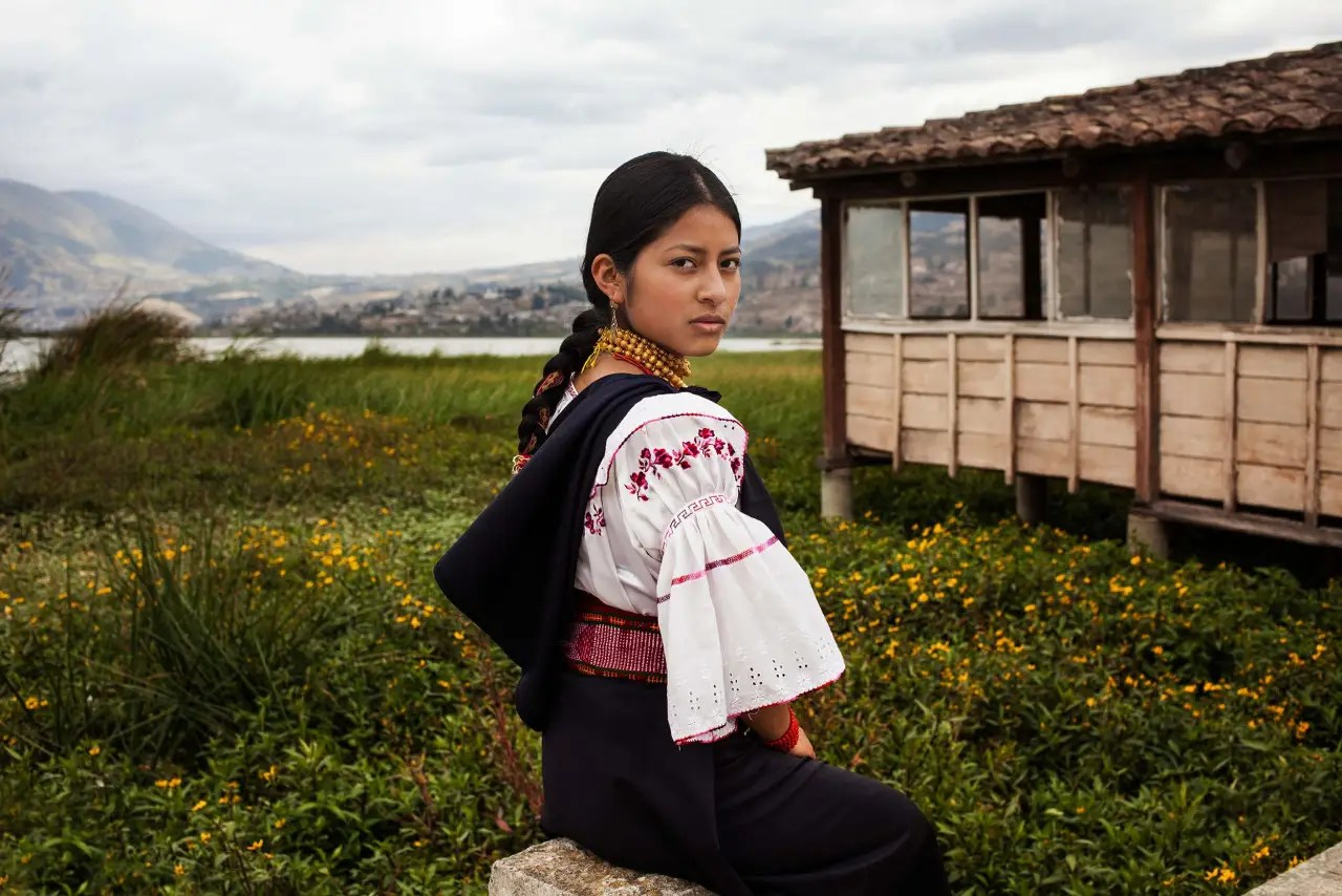 Wearing traditional dress in Otavalo, Ecuador.