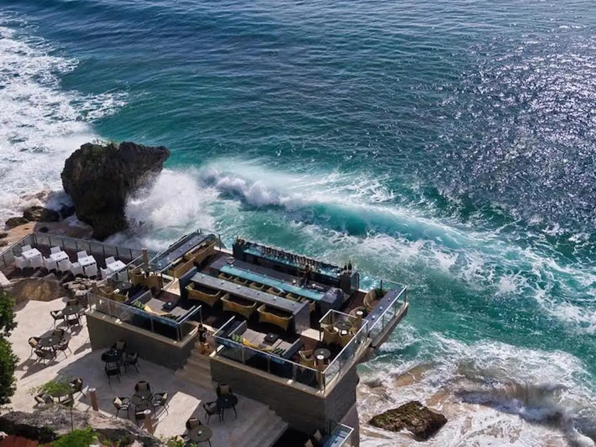Rock Bar in Kuta, Bali, is carved into a cliff face and overlooks the Indian Ocean from a rocky perch 46 feet above crashing waves. Even better than sitting on the water? Having to take a four-person cable car to get there.