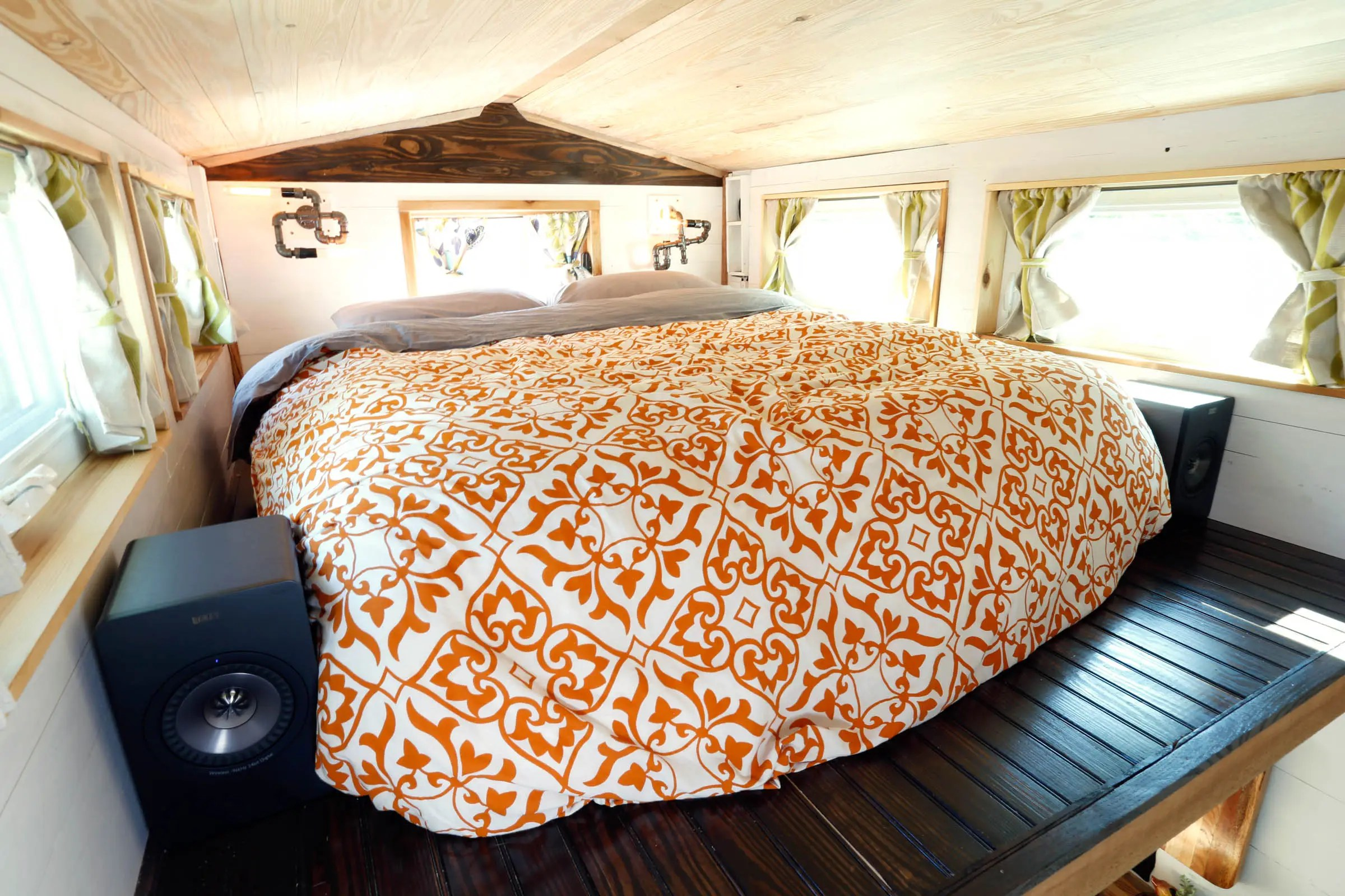 It has a queen bed and an abundance of windows, which helps make the tight quarters feel a little more spacious.