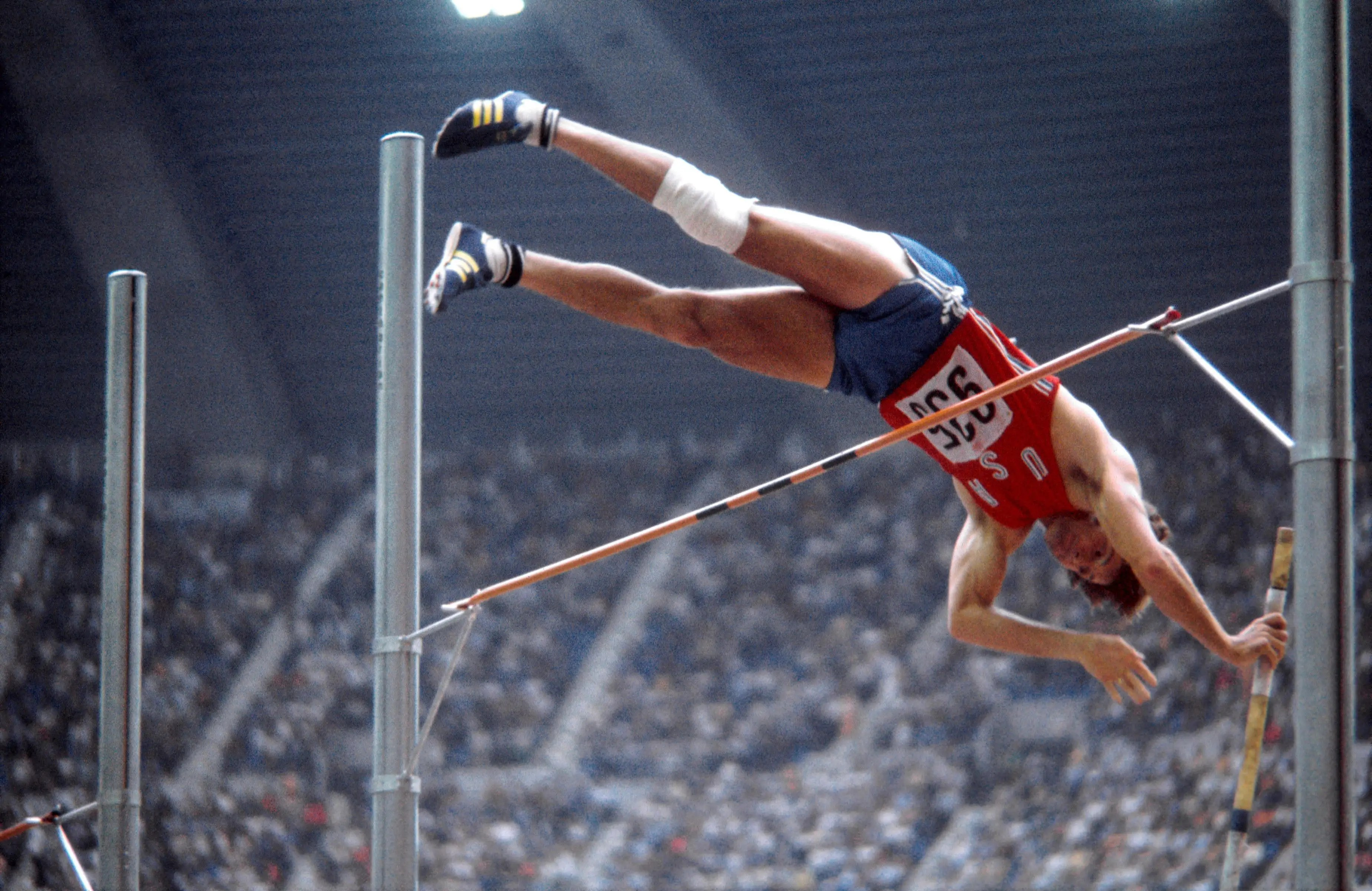 Montreal, 1976: The USA's Bruce Jenner became one of the country's most celebrated athletes this year by winning gold. This photo shows him clearing the bar during the pole vault discipline of the decathlon. 22 African nations boycotted the Olympics in 1976 after New Zealand sent its national rugby team to play in South Africa, which was under apartheid rule.