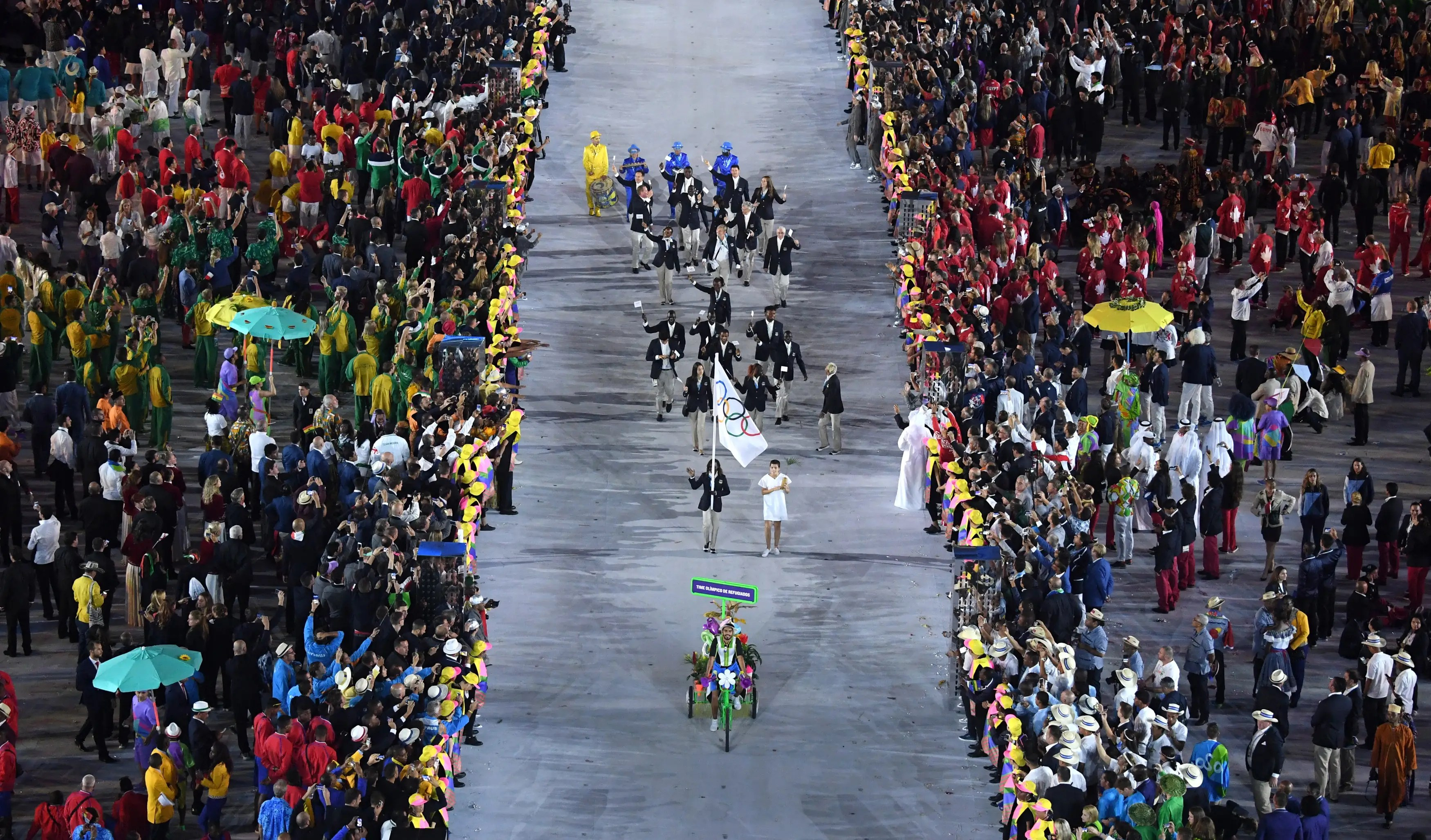 2016: The 2016 Rio Olympics welcomed the first ever team made up entirely of refugees. The Refugee Olympic Team received the biggest applause during the opening ceremony and consists of athletes from South Sudan, Ethiopia, Syria, and the Democratic Republic of Congo. Rose Nathike Lokonyen, originally from South Sudan, carried the team's Olympic flag.