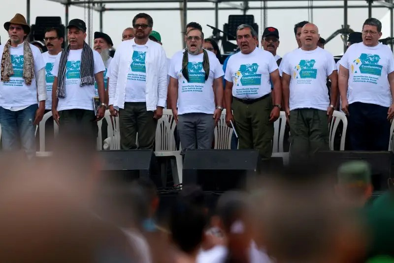FARC rebel leader Rodrigo Londono, better known by hs nom de guerre Timochenko, and leaders sing the anthem during the opening of ceremony congress at the camp where they prepare for ratifying a peace deal with the government, near El Diamante in Yari Plains, Colombia, September 17, 2016.  REUTERS /John Vizcaino