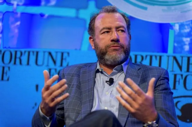 Dan Ammann (R), President of General Motors speaks during the Fortune Brainstorm Tech conference in Aspen, Colorado, U.S. in this handout photo released to Reuters July 11, 2016. Stuart Isett/Fortune Brainstorm TECH/Handout via Reuters