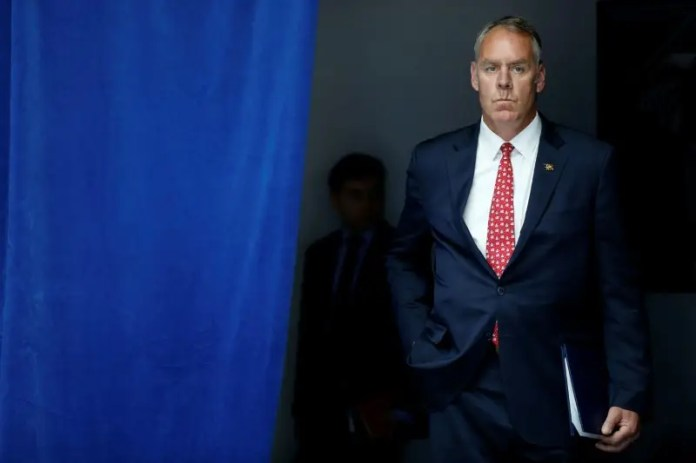 U.S. Interior Secretary Ryan Zinke waits to take the stage with President Donald Trump for his on infrastructure improvements, at the Department of Transportation in Washington, U.S. June 9, 2017.  REUTERS/Jonathan Ernst  Trump will soon reveal whether he'll eliminate national monuments Trump will soon reveal whether he'll eliminate national monuments us national monument review to test key land protection law 2017 8