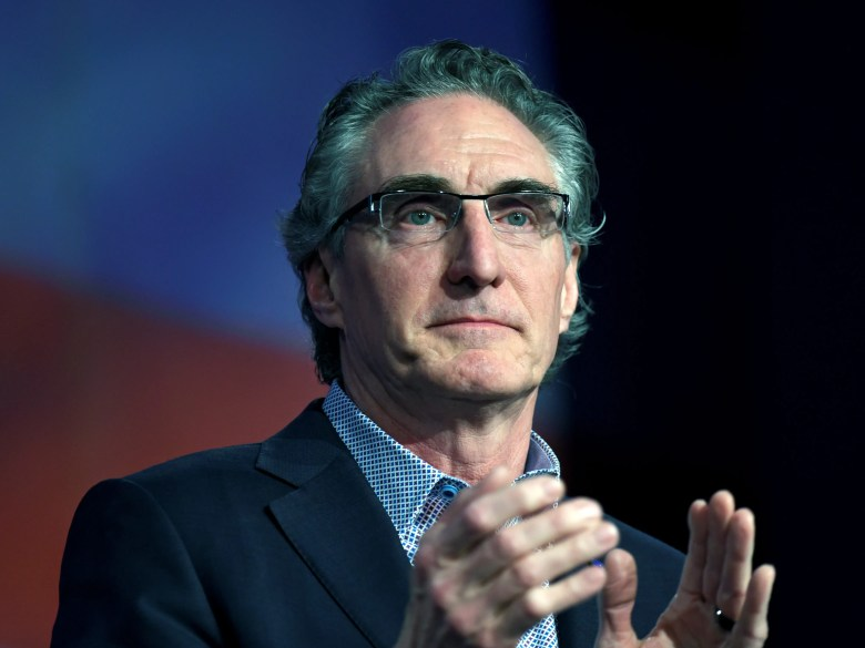 FILE PHOTO: Governor Doug Burgum (R-ND) speaks to delegates at the Republican State Convention in Grand Forks, North Dakota, U.S. April 7, 2018. Picture taken April 7, 2018. REUTERS/Dan Koeck